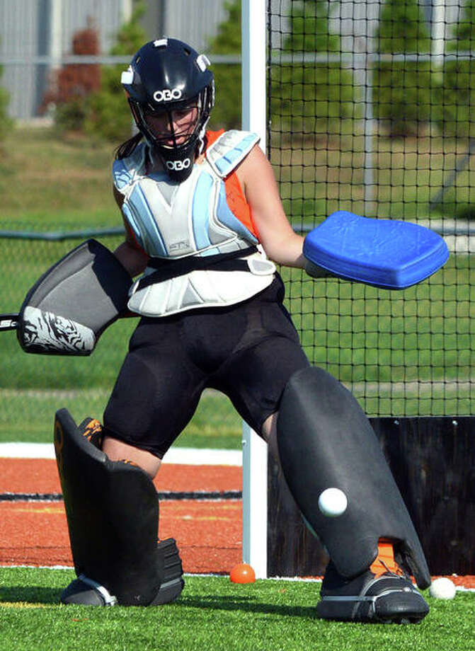 Edwardsville goalie Leah Griffin makes a kick save during practice last week. Griffin, a senior, is a first-year starter. Photo: Scott Marion/The Intelligencer