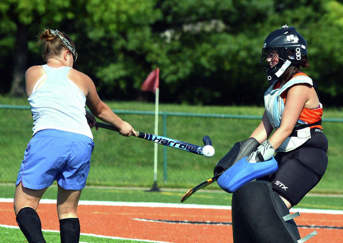 Edwardsville goalie Leah Griffin, right, makes a save during practice last week. . Griffin, a senior, is a first-year starter.