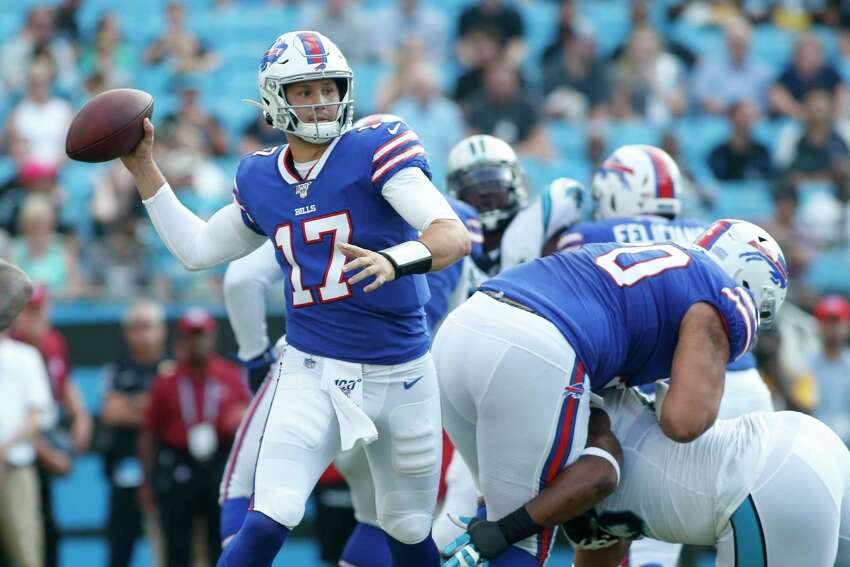 Buffalo Bills quarterback Josh Allen (17) works against the Carolina Panthers during the first half an NFL preseason football game, Friday, Aug. 16, 2019, in Charlotte, N.C. (AP Photo/Brian Blanco)