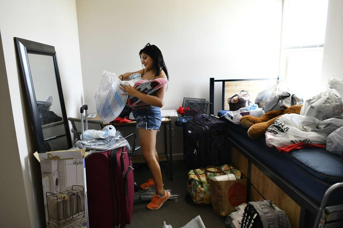 Miranda Pacheco, freshman psychology major from Houston, gets her dorm room in order at Esperanza Hall on the Texas A&M University-San Antonio campus on Friday, Aug. 16, 2019. Almost 400 students live in the three-year-old dorm, which is at capacity.