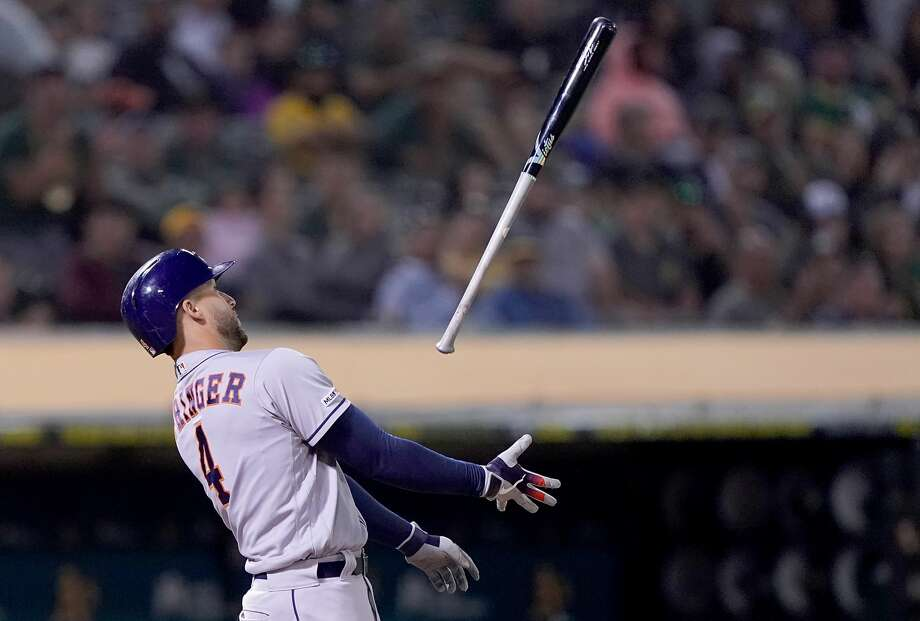 OAKLAND, CA - AUGUST 16:  George Springer #4 of the Houston Astros tosses his bat in the air after striking out against the Oakland Athletics in the top of the 10th inning at Ring Central Coliseum on August 16, 2019 in Oakland, California.  (Photo by Thearon W. Henderson/Getty Images) Photo: Thearon W. Henderson/Getty Images