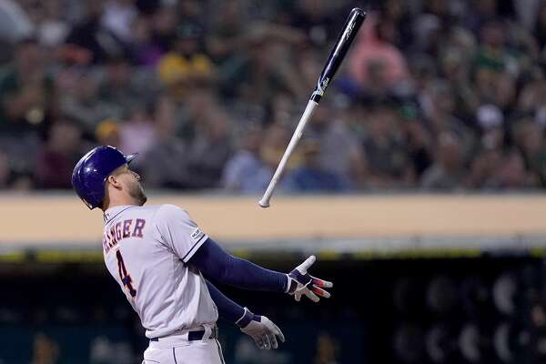OAKLAND, CA - AUGUST 16: George Springer #4 of the Houston Astros tosses his bat in the air after striking out against the Oakland Athletics in the top of the 10th inning at Ring Central Coliseum on August 16, 2019 in Oakland, California. (Photo by Thearon W. Henderson/Getty Images)