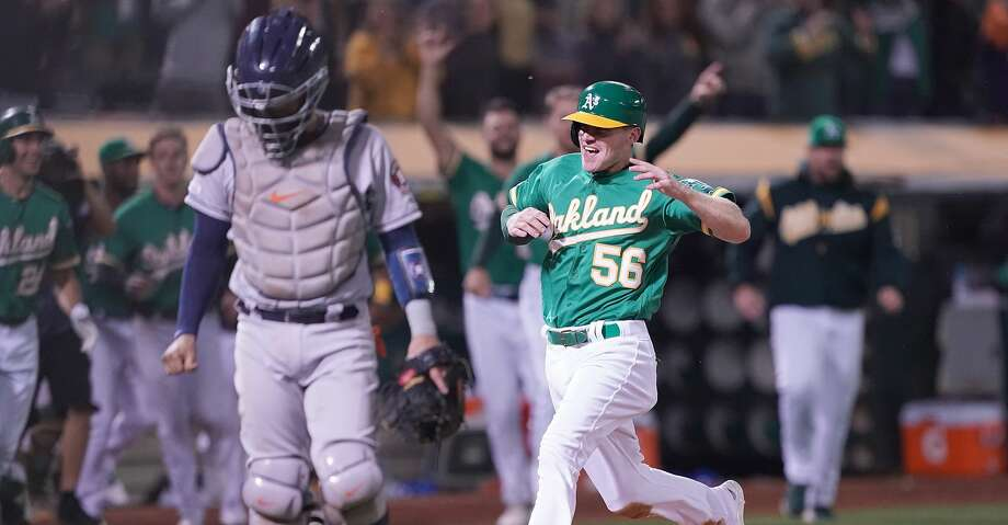 OAKLAND, CA - AUGUST 16:  Corban Joseph #56 of the Oakland Athletics scores the winning run against the Houston Astros in the bottom of the 13th inning at Ring Central Coliseum on August 16, 2019 in Oakland, California. The Athletics won the game 3-2. (Photo by Thearon W. Henderson/Getty Images) Photo: Thearon W. Henderson/Getty Images
