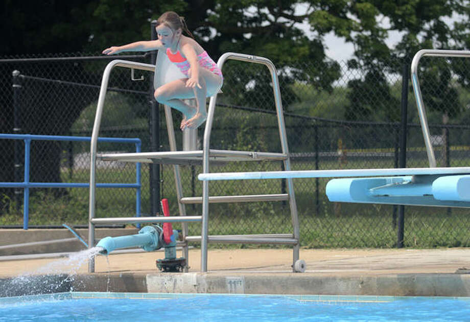Hope Brosi, 6, leaps Friday into the Nichols Park pool. She starts first grade on Monday. Photo: Rosalind Essig | Journal-Courier