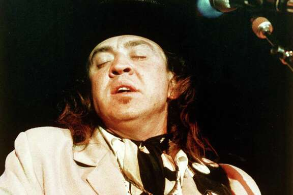 Blues guitarist Stevie Ray Vaughan is seen performing onstage at the Rhythm and Blues Foundation Benefit in Austin, Texas, in this 1988 photo. (AP Photo/Lisa Davis)