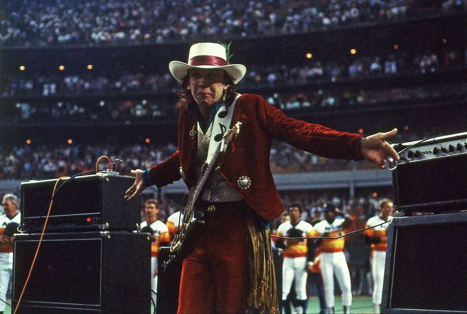 Musician Stevie Ray Vaughan following his performance of the national anthem on his guitar, April 9, 1985, at the Astrodome. Photo: Cathy Ambrose Smith, HP Staff / Houston Chronicle / Houston Chronicle