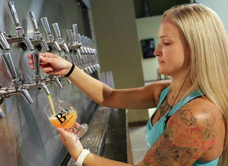 B52 beer-tender and supervisor Lainie Powell pours a glass of their Super Fruited Imperial Sour: Strawberry Lemonade, which is more than 11 percent alcohol by volume.