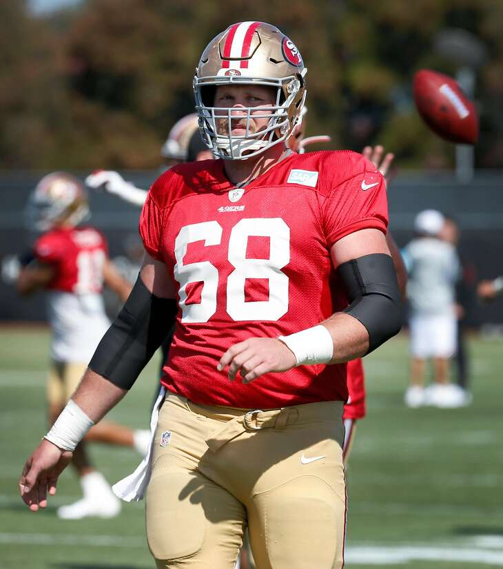 Offensive lineman Mike Person rests between drills at a San Francisco 49ers practice session in Santa Clara, Calif. on Tuesday, July 30, 2019.