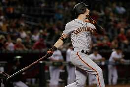 San Francisco Giants' Mike Yastrzemski follows through on a solo home run during the 11th inning of the team's baseball game against the Arizona Diamondbacks, Friday, Aug. 16, 2019, in Phoenix. It was Yastrzemski's third home run of the game.