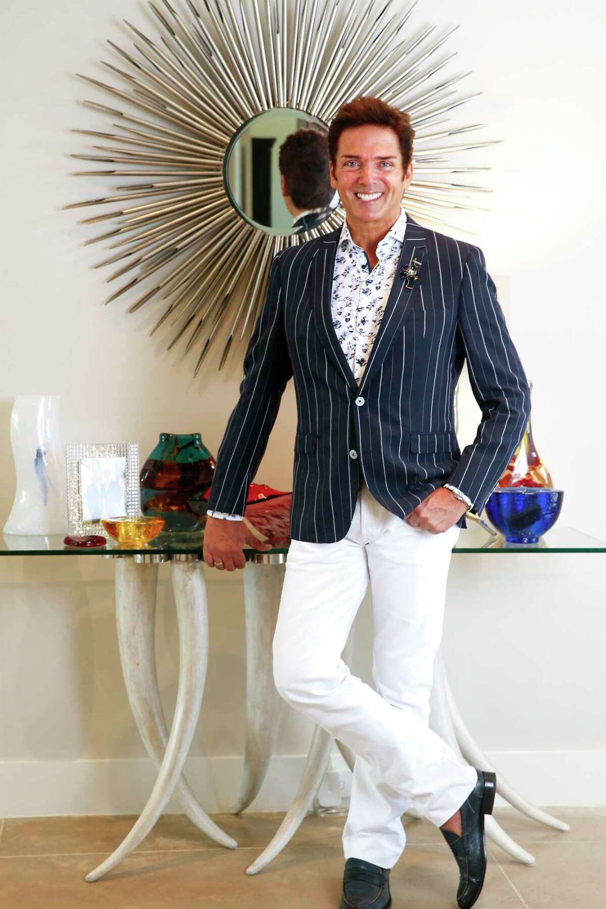 Style profile on Lenny Matuszewski, veteran fashion show producer who began his career as a model traveling throughout the United States and Europe working for such fashion designers as Calvin Klein, Perry Ellis, Giorgio Armani, Dolce & Gabbana, Hugo Boss, Missoni and many others. In his Houston home on Wednesday, Aug. 7, 2019 in Houston.