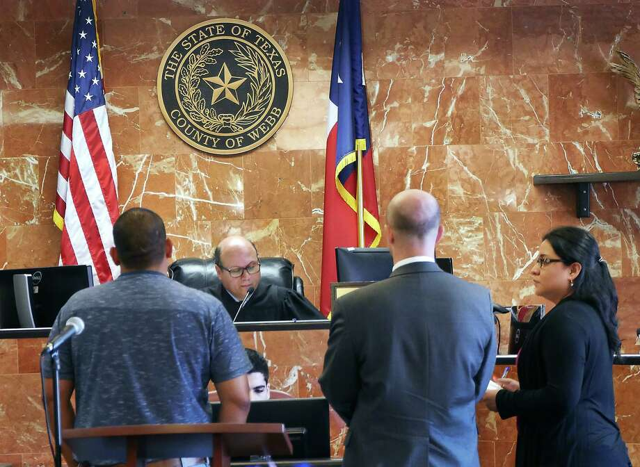 As part of the Drug Court Program, 406th District Judge Oscar J. Hale Jr., clears the case of one of 11 adults who completed a judicially supervised treatment program allowing them to participate in an Adult Drug Program Graduation Thursday. Photo: Cuate Santos / Laredo Morning Times / Laredo Morning Times