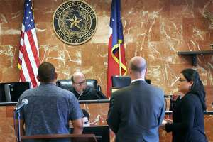 As part of the Drug Court Program, 406th District Judge Oscar J. Hale Jr., clears the case of one of 11 adults who completed a judicially supervised treatment program allowing them to participate in an Adult Drug Program Graduation Thursday.