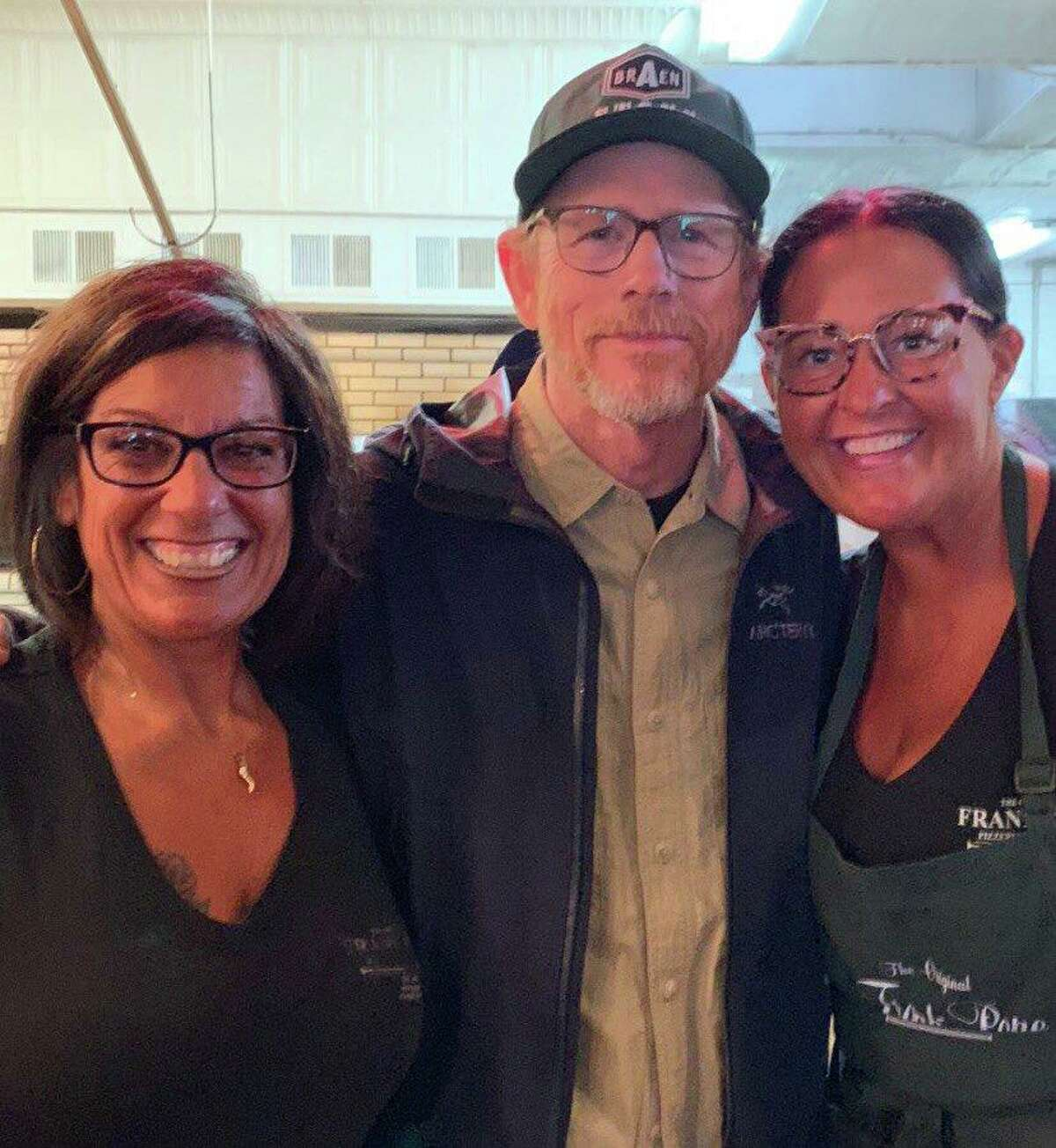 """Academy Award-winning filmmaker Ron Howard meets with the staff at Pepe's Pizza after dropping in for lunch at the location in New Haven. Howard is in town to film """"Hillbilly Elegy."""""""