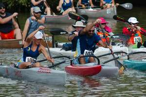 Participants paddle their canoes, kayaks and paddle boards down Clear Creek during the Clear Creek Paddle Race Saturday, Aug. 17 at Lynn Gripon Park.