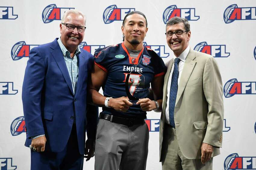 Arena Football League Chairman of the Executive Committee Ron Jaworski ,left, and Commissioner Randall Boe ,right, flank Offensive Player of the Year Malachi Jones during the Arena Football League 2019 award ceremony at the Times Union Center, Saturday, Aug. 10, 2019, in Albany, N.Y. (Hans Pennink / Special to the Times Union)