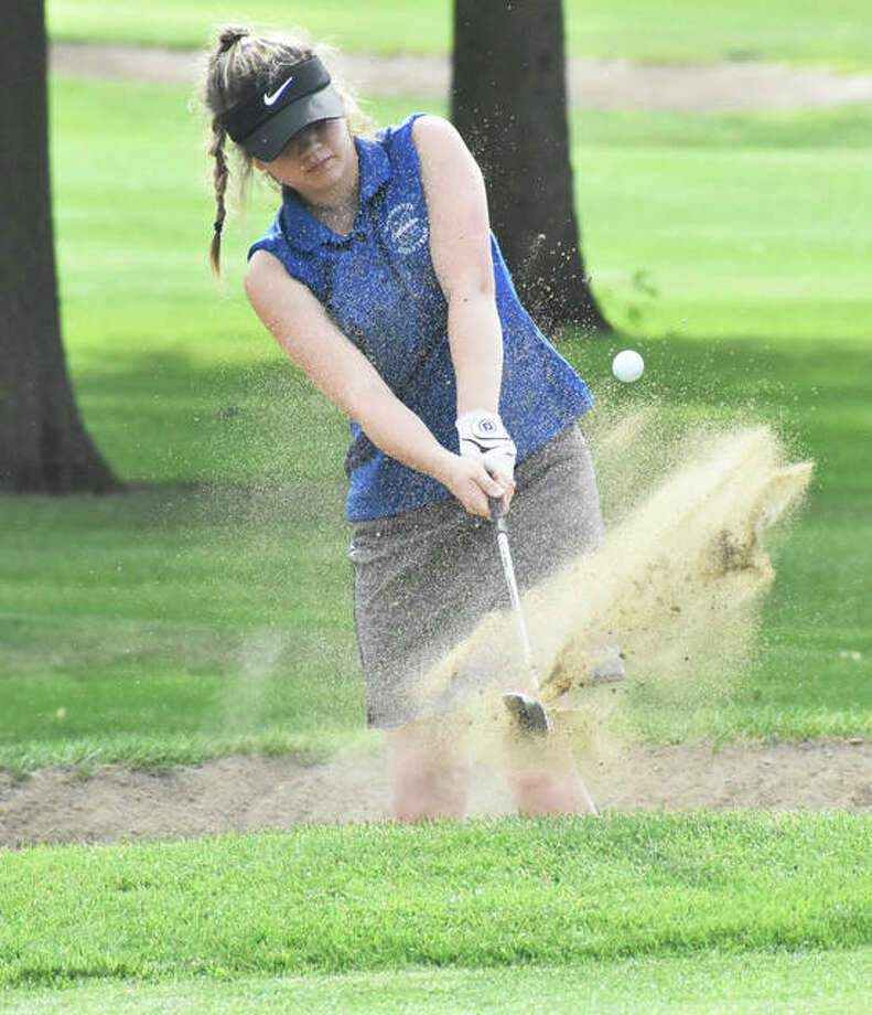 Marquette Catholic's Audrey Cain chips out of the sand onto the green during her round of 87 Friday at the Prep Tour Showcase at Hickory Point Golf Club in Forsyth. Photo: Matt Kamp / Hearst Illinois