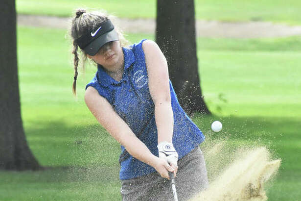 Marquette Catholic's Audrey Cain chips out of the sand onto the green during her round of 87 Friday at the Prep Tour Showcase at Hickory Point Golf Club in Forsyth.