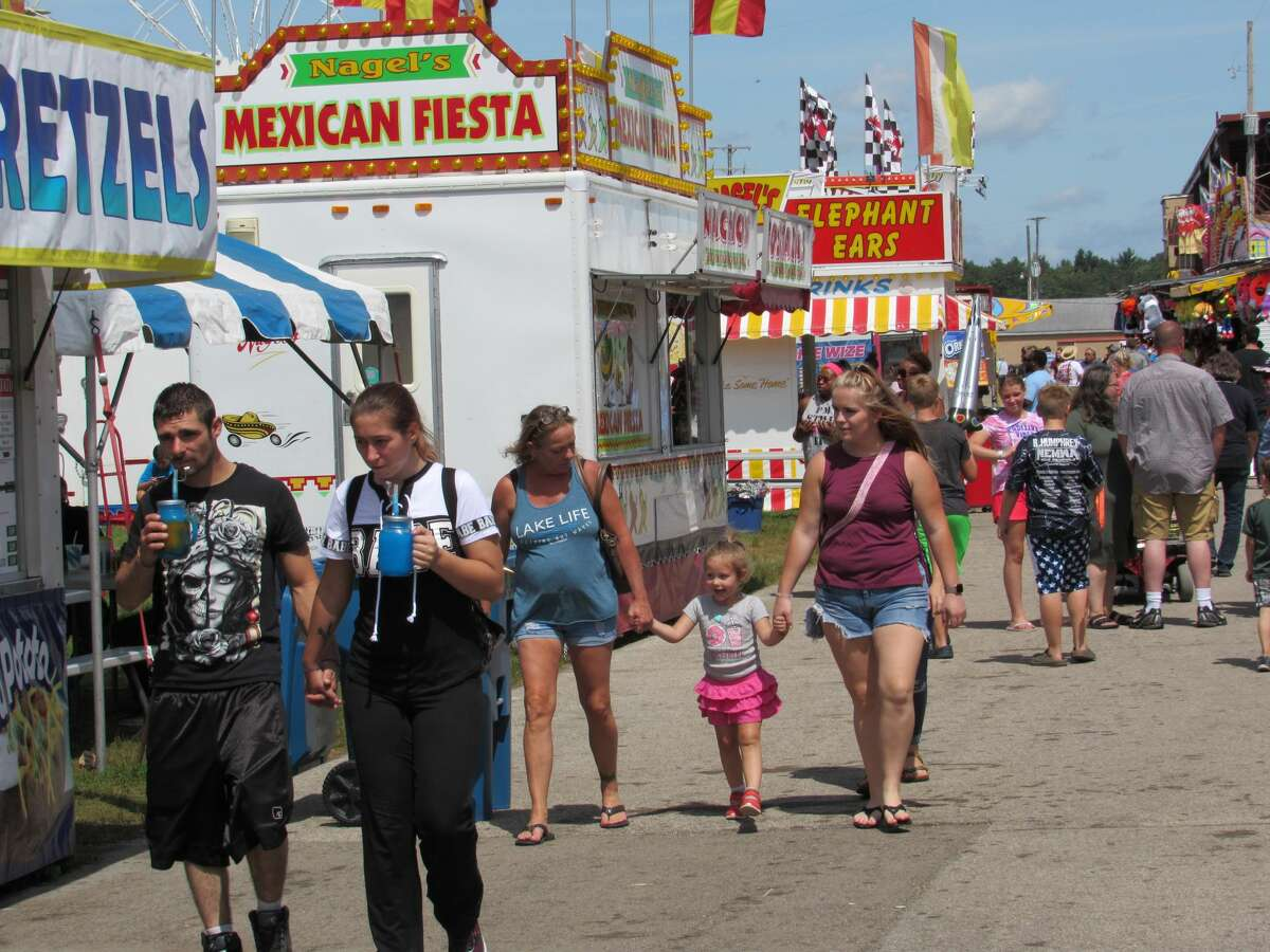 Visitors to the Midland County Fair on Saturday, Aug. 17, 2019 enjoy rides, games, food and events.