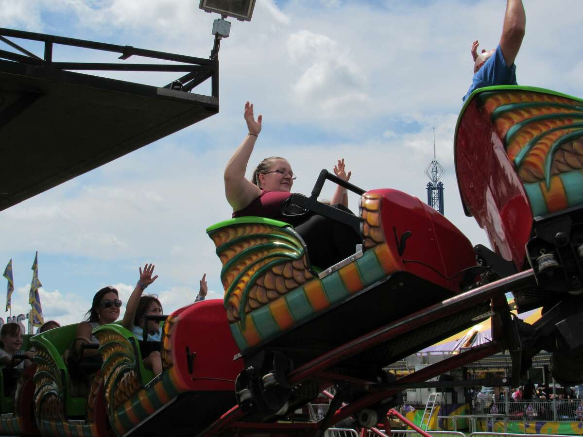 Visitors to the Midland County Fair on Saturday, Aug. 17 enjoy rides, games, food and events.