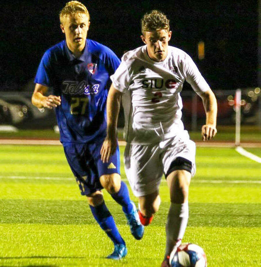 SIUE's Danel Calvillo (right), a redshirt junior from Spain, pushes the ball upfield while Tulsa's Ben Barkley pursues the play Friday night at Korte Stadium in Edwardsville. Photo: SIUE Athletics