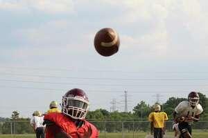 Summer Creek quarterback Bryan Bush warming up before practice.