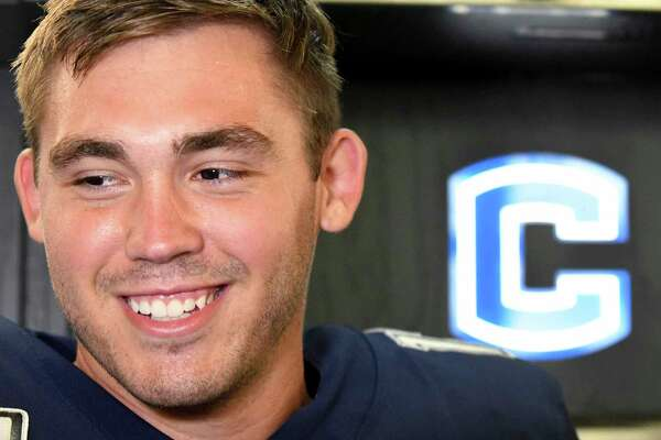 Mike Beaudry, named starting quarterback Tuesday, smiles while talking to reporters during UConn football media day on July 30 in Storrs.