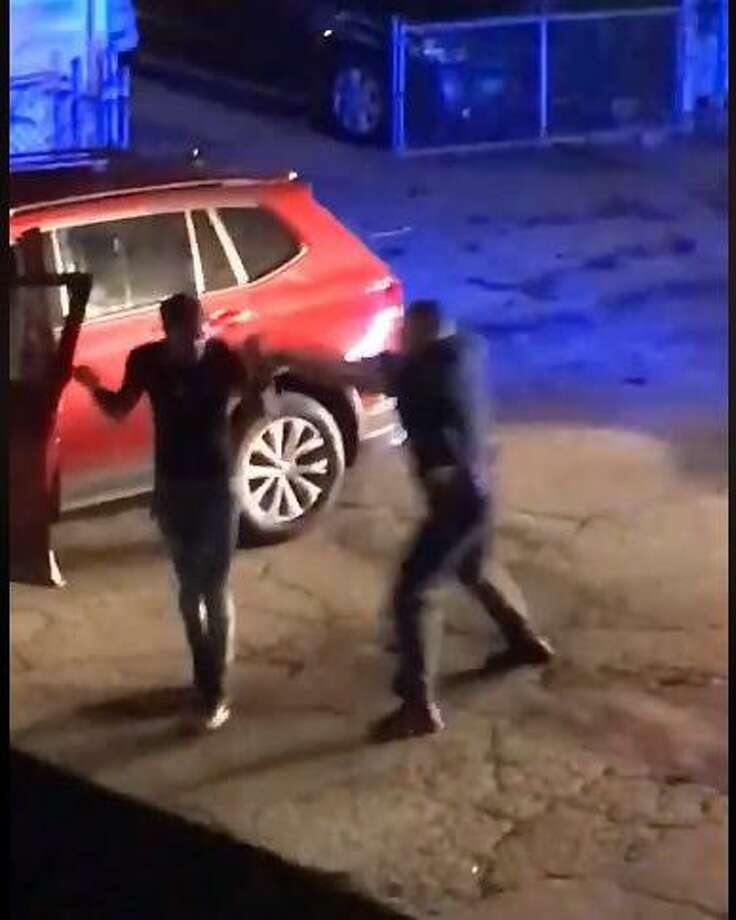 This screenshot of the Facebook video shows the moment just before the officer hits the suspect in the back of the head with the gun. Photo: Contributed Photo / Screenshot Of The Facebook Video