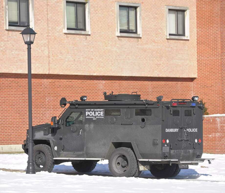 A Danbury Police Department Emergency Services Unit is parked next to Litchfield Hall during a Western Connecticut State University Police Department live shooting exercise with Danbury and other area police departments at the WCSU midtown campus Campus on Thursday, February 11, 2016, in Danbury, Conn. The training drill took place in the university's Litchfield Hall dormitory building. Photo: H John Voorhees III / Hearst Connecticut Media / The News-Times