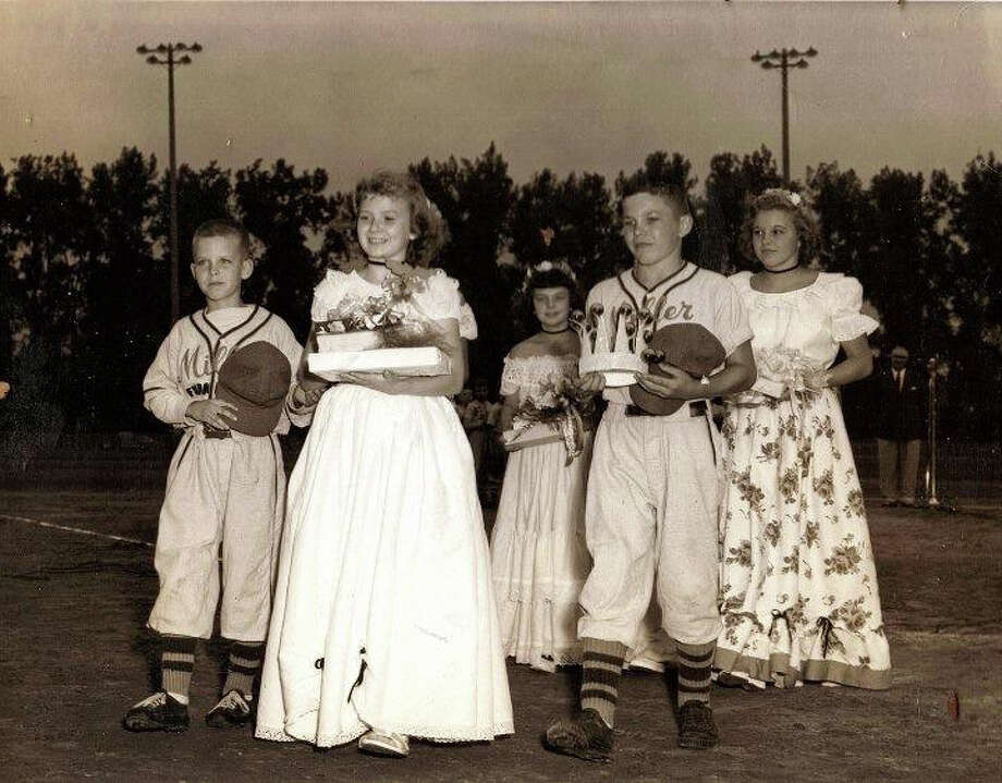Tom Roberts (front right) helps escort Little League queen — and his future wife — Kathy Brown (front middle) during 1951 opening ceremonies at Currie Stadium. Photo: Photo Provided