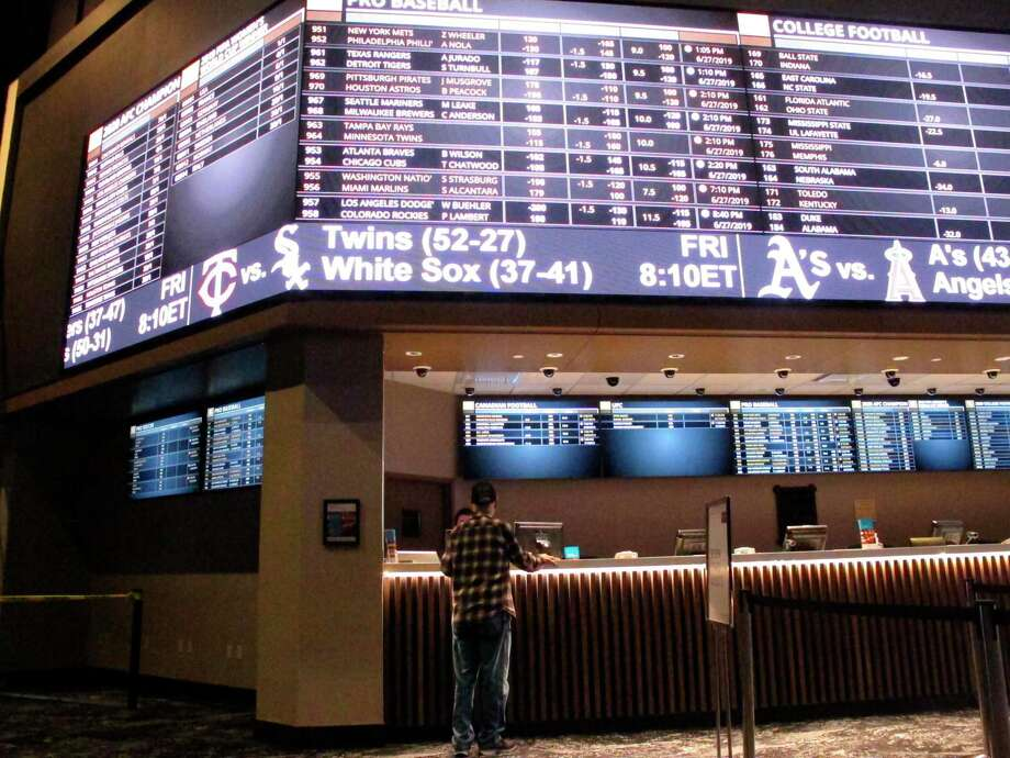 A customer ponders the odds at the sportsbook at Bally's casino in Atlantic City, N.J. Photo: Wayne Parry / Associated Press / Copyright 2019 The Associated Press. All rights reserved.