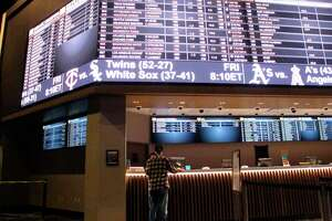A customer ponders the odds at the sportsbook at Bally's casino in Atlantic City, N.J.