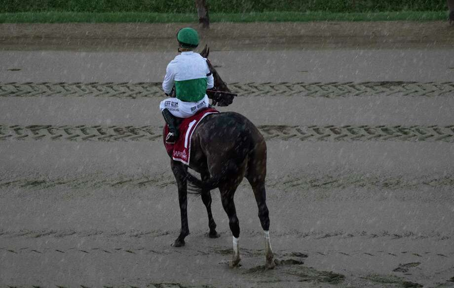 It will be another hot and wet day in the Capital Region. In this photograph, Varenka with jockey Javier Castellano on his back  weathers a significant rain storm at Saratoga Race Course. (Skip Dickstein / Special to the Times Union)