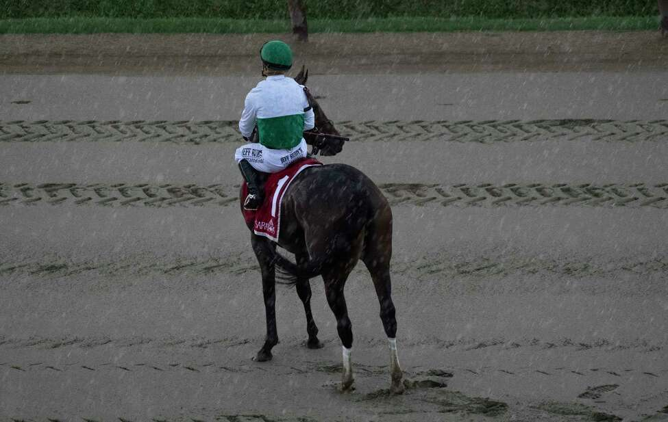 Varenka with jockey Javier Castellano aboard weathers a significant rain storm hit the Saratoga Race Course while waiting for a judgement which was consider a dead heat in the 36th running of The Lake Placid Saturday Aug. 17, 2019 in Saratoga Springs, N.Y. Photo Special to the Times Union by Skip Dickstei