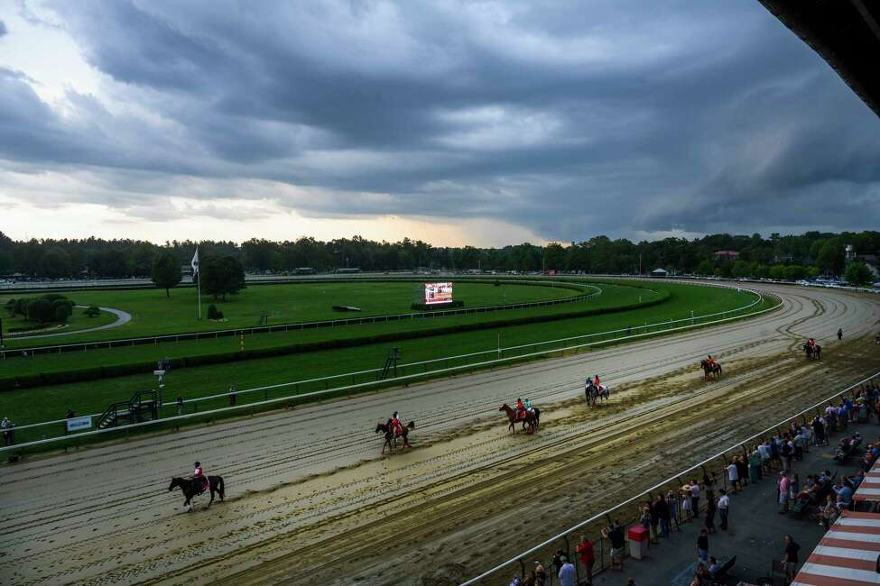 Horses head to the post in the 36th running of The Lake Placid asa significant rain storm hits the Saratoga Race Course Saturday Aug. 17, 2019 in Saratoga Springs, N.Y. Photo Special to the Times Union by Skip Dickstein