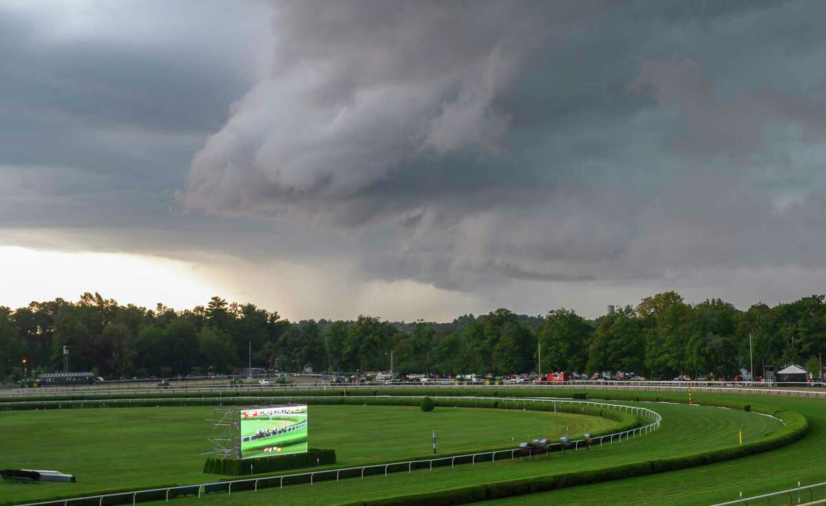 Horses head to the post in the 36th running of The Lake Placid as a significant rain storm hits the Saratoga Race Course Saturday Aug. 17, 2019 in Saratoga Springs, N.Y. Photo Special to the Times Union by Skip Dickstei