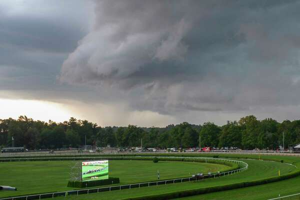 Horses head to the post in the 36th running of The Lake Placid asa significant rain storm hits the Saratoga Race Course Saturday Aug. 17, 2019 in Saratoga Springs, N.Y. Photo Special to the Times Union by Skip Dickstei