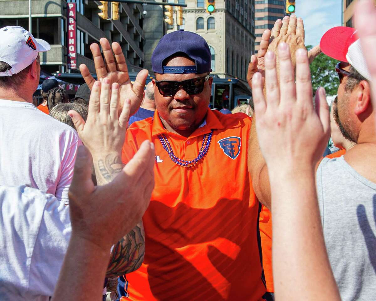 Albany Empire fullback Mykel Benson is greeted by fans during a block party held in front of the Times Union Center on Saturday, Aug. 17, 2019, to celebrate the team's Arena Bowl win (Jim Franco/Special to the Times Union.)