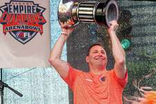 Albany Empire COO George Manias hoists the AFL Championship Cup during a block party held in front of the Times Union Center on Saturday, Aug. 17, 2019, to celebrate the team's Arena Bowl win (Jim Franco/Special to the Times Union.)
