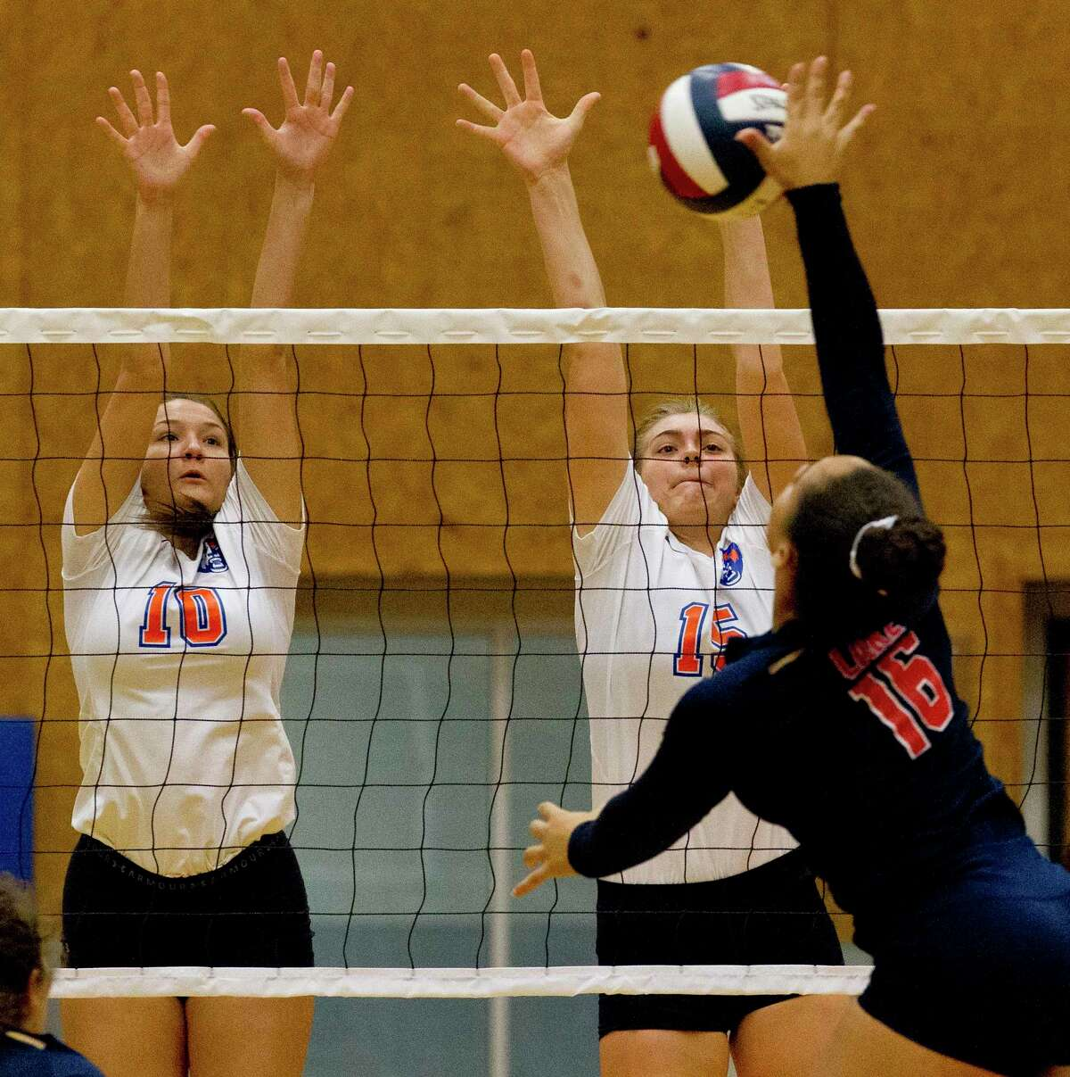 Grand Oaks outside hitter Aidan Ballard (15) and defensive specalist Ryee O'Malley (10) pressure a shot in the first set of a match during the Spring ISD Varsity Volleyball Classic at Dekaney High School, Saturday, Aug. 17, 2019, in Houston.