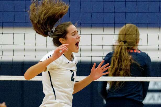 College Park's Noelle Palmer (2) reacts after scoring a point in the first set of a match during the Kingwood Invitational volleyball tournament at Kingwood High School, Saturday, Aug. 17, 2019, in Kingwood.