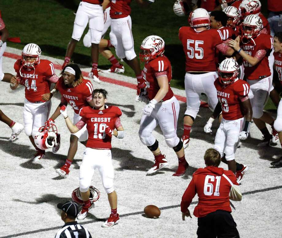 Crosby players storm the field after a last second touchdown to win 49-47 over Manvel during a high school football game at Cougar Stadium between Manvel and Crosby High Schools, Friday, September 7, 2018, in Crosby. Photo: Karen Warren, Houston Chronicle / Staff Photographer / © 2018 Houston Chronicle