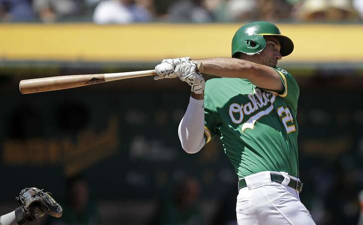 Oakland Athletics' Matt Olson swings for an RBI-single off Houston Astros' Rogelio Armenteros in the third inning of a baseball game Saturday, Aug. 17, 2019, in Oakland, Calif. (AP Photo/Ben Margot)