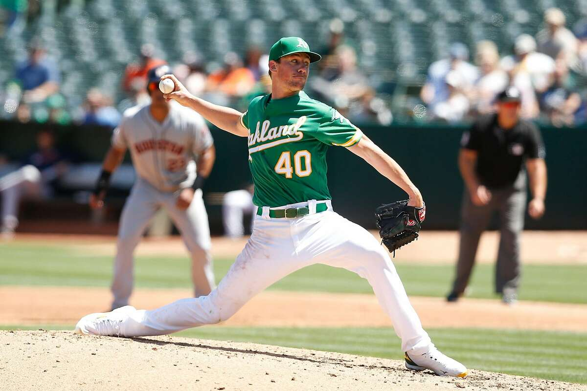 OAKLAND, CALIFORNIA - AUGUST 17: Chris Bassitt #40 of the Oakland Athletics pitches in the top of the third inning against the Houston Astros at Ring Central Coliseum on August 17, 2019 in Oakland, California. (Photo by Lachlan Cunningham/Getty Images)