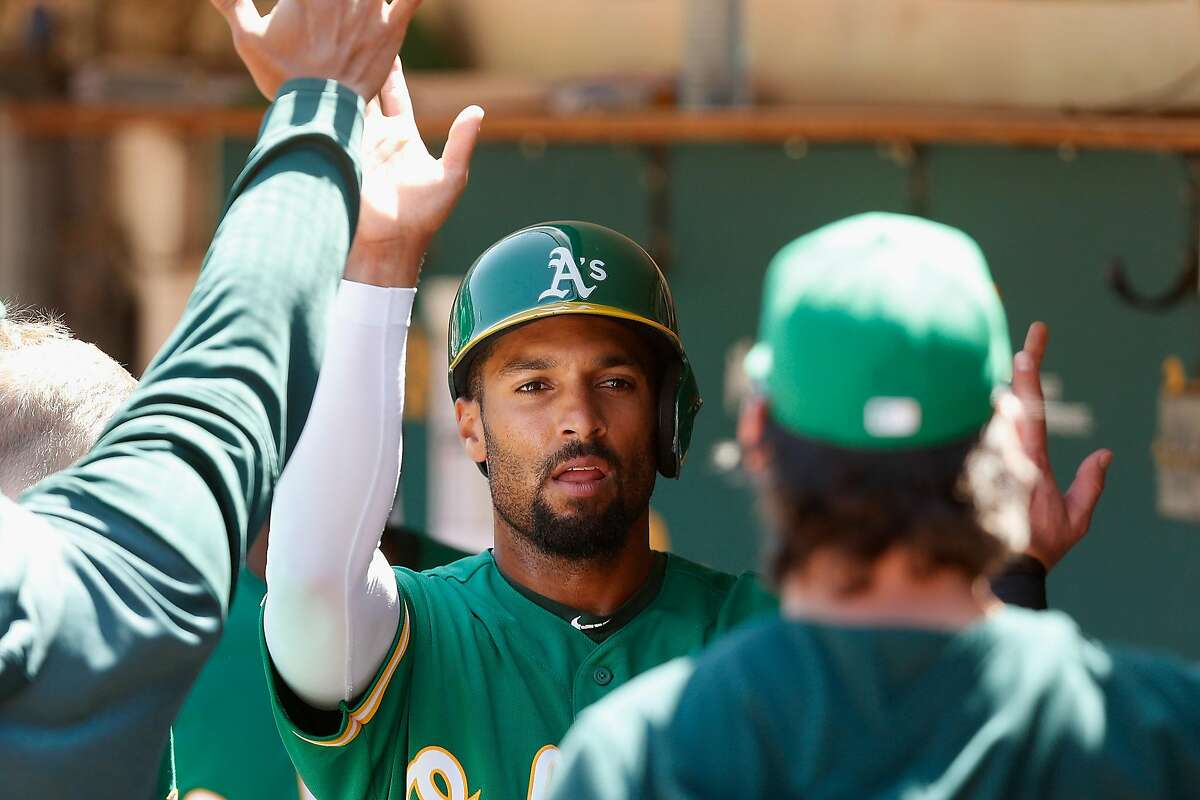 OAKLAND, CALIFORNIA - AUGUST 17: Marcus Semien #10 of the Oakland Athletics celebrates after scoring on a single hit by Matt Olson #28 in the bottom of the third inning against the Houston Astros at Ring Central Coliseum on August 17, 2019 in Oakland, California. (Photo by Lachlan Cunningham/Getty Images)