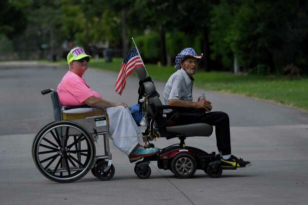 Wenzle Hufford tows his wife, Lucynda, in Kennett, Missouri, on July 17, 2019. They live more than an hour's drive from the Poplar Bluff Regional Medical Center, where they would be taken by ambulance if a severe health emergency occurred.
