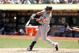 OAKLAND, CALIFORNIA - AUGUST 17: Michael Brantley #23 of the Houston Astros hits a sigle in the top of the third inning against the Oakland Athletics at Ring Central Coliseum on August 17, 2019 in Oakland, California. (Photo by Lachlan Cunningham/Getty Images)