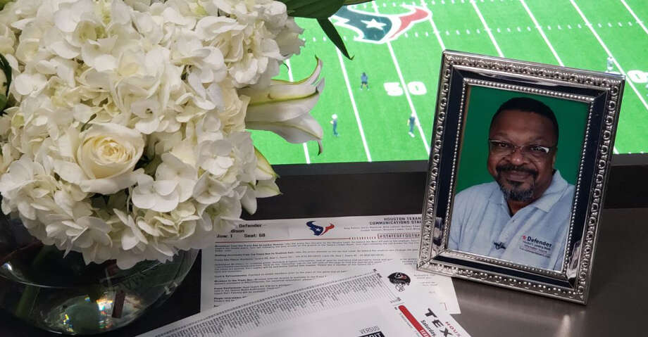 Aug. 17, 2019: Texans PR prepared a flower display and framed photograph in the front row of the press box at NRG Stadium for the late Houston Defender sports editor Max Edison. Photo: Aaron Wilson