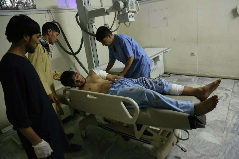 A wounded man receives treatment at a hospital after an explosion at wedding hall in Kabul, Afghanistan, early Sunday, Aug. 18, 2019. An explosion ripped through a wedding hall on a busy Saturday night in Afghanistan's capital and dozens of people were killed or wounded, a government official said. Hundreds of people were believed to be inside. (AP Photo/Nishanuddin Khan)