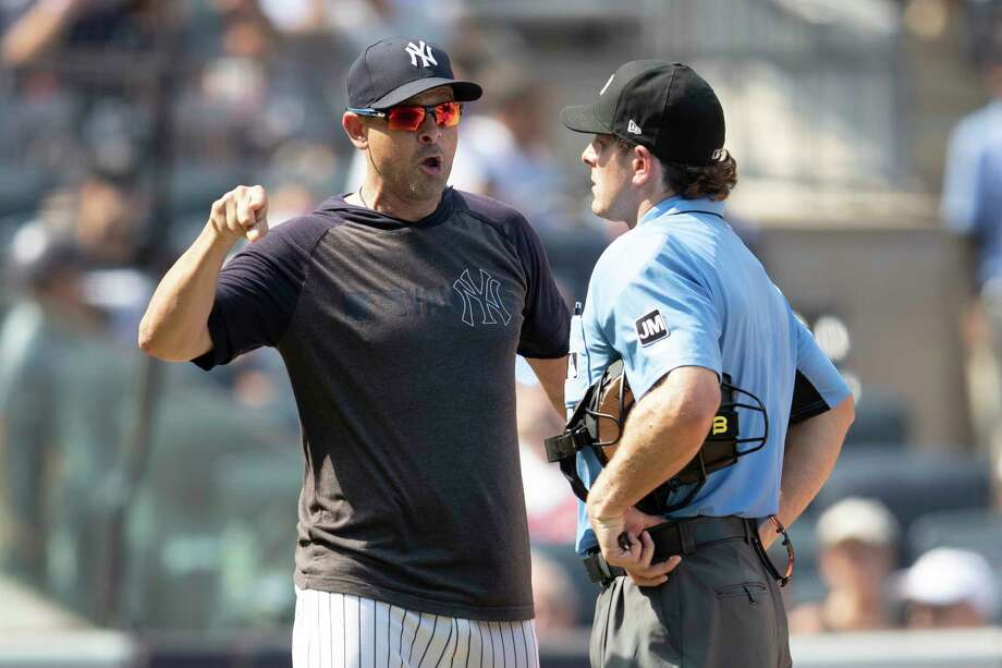 New York Yankees manager Aaron Boone, right, argues with Home plate umpire Ben May after being ejected during the sixth inning of a baseball game, Saturday, Aug. 17, 2019, in New York. (AP Photo/Mary Altaffer) Photo: Mary Altaffer / Copyright 2019 The Associated Press. All rights reserved.
