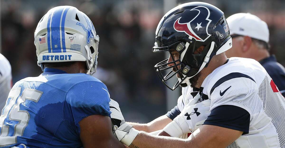 Detroit Lions defensive end Romeo Okwara (95) and Houston Texans offensive tackle Matt Kalil (75) go up against each other during a joint training camp practice with the Detroit Lions at the Houston Methodist Training Center on Wednesday, Aug. 14, 2019, in Houston.